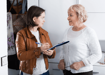 Fired from House Cleaning, Woman With Clipboard Talking to Woman