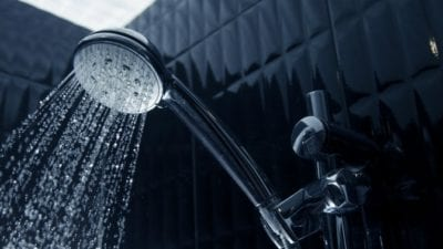 Imagine shower head with water