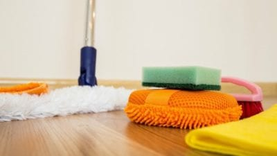 cleaning supplies strewn about on hardwood floor
