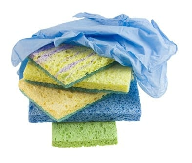 Dirty cleaning sponges with used disposable gloves