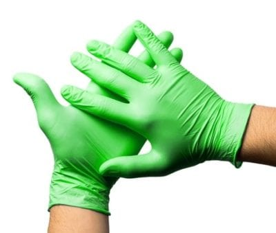 clapping hands wearing green latex gloves