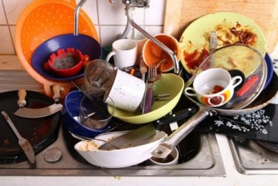 Cleaning Mistakes Letting Dishes Pile Up