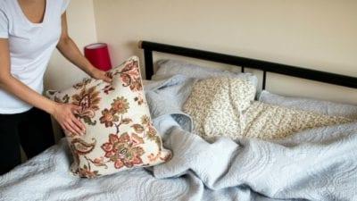 Habits lady arranging pillows