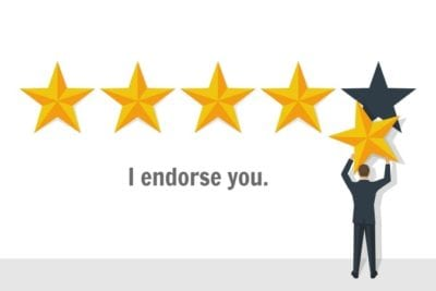 Man with 5 stars making ratings and reviews