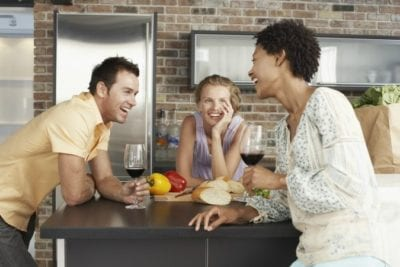 Messy House Family chatting in kitchen