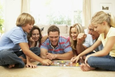 Messy House Happy Family playing board game