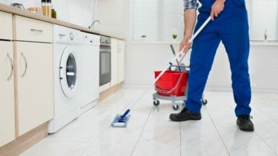 organizing vs. house cleaning - man mops floor