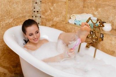 Pumice Stones, Woman in Bath Using Pumice Stone