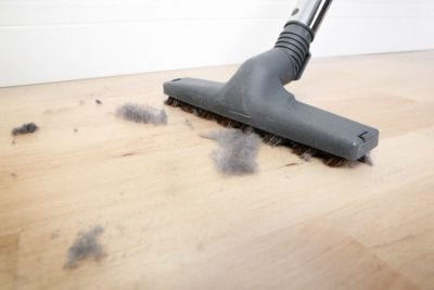 http://askahousecleaner.com/wp-content/uploads/2018/03/Backpack-Vacuums-Vacuuming-Dust-on-Wood-Floor.jpg