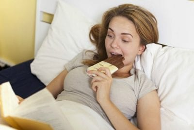 Extra Charge for Extra People, Girl Eating Chocolate in Bed