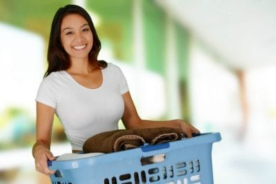 Extra Charge for Extra People, Smiling Woman With Laundry Basket