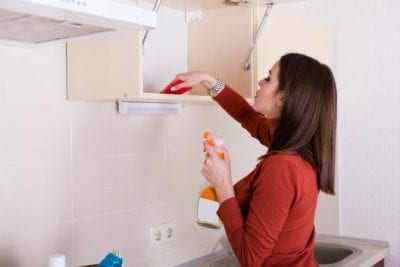 Furniture Polish, Woman Cleaninng Kitchen Cabinets