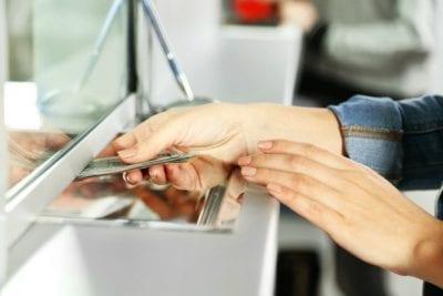 Hardest Job, Hardest Money Hand receives money through pay window