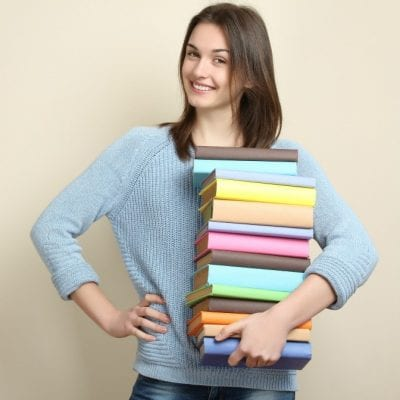 Hoarding Woman Holds Stacks of Books