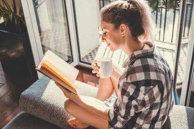 Hoarding Woman reads book