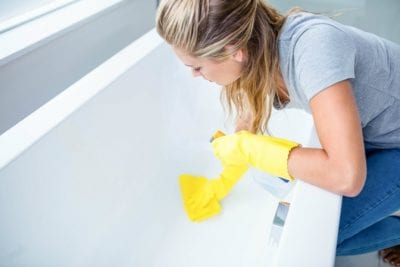 Keeping Uniforms Looking Nice, Woman Cleaning Tub