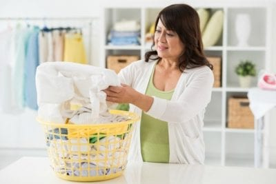 Keeping Uniforms Looking Nice, Woman Doing Laundry