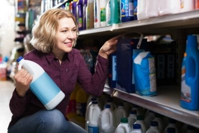 Keeping Uniforms Looking Nice, Woman Looking at Cleaning Supplies