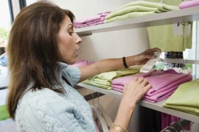 Keeping Uniforms Looking Nice, Woman Looking at Prices of Shirts