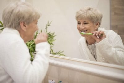 Menopause and House Cleaning, Happy Woman Brushing Teeth