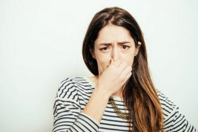 Mystery Smell, Woman Holding Nose