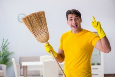 One Offs, Smiling, Questioning Man With Broom Holding Finger Up