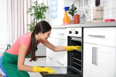 One-Offs, Woman Cleaning an Oven