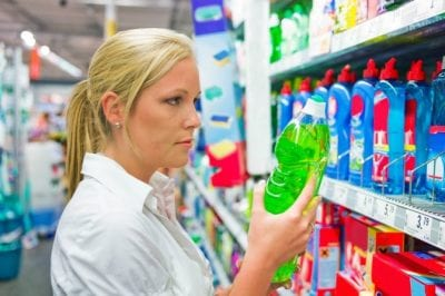 Annual Cost of Cleaning Supplies, Woman Looking at Cleaning Supply