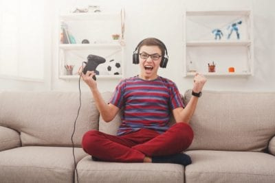 Get a Teenager to Clean Up, Excited Teen Playing Video Game