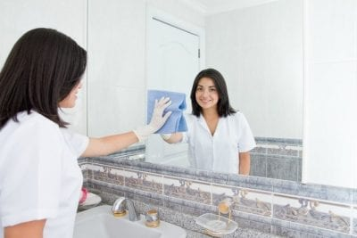 Qualifications for House Cleaning, House Cleaner Wiping Mirror