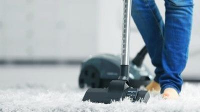 Speed Cleaning Vacuum Style Man vacuums carpet