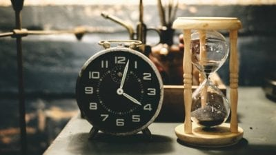 Startup Struggles Clock and hourglass illustrate limited time