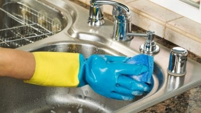 Startup Struggles gloved hand washing dishes