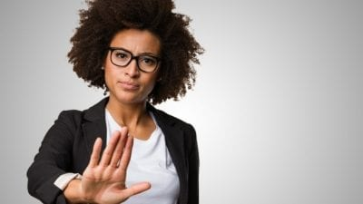Tax Tips African American Woman with hand out saying No