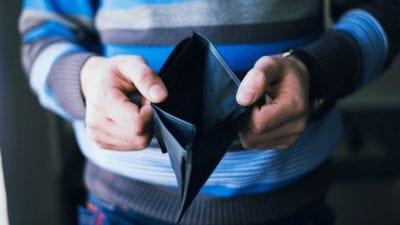 Tax Tips Close up Hands holding empty wallet