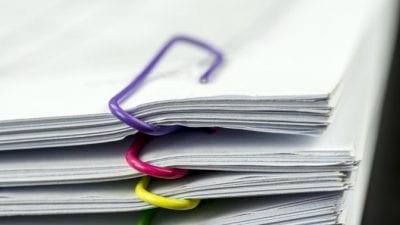 Tax Tips Stacks of legal documents