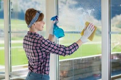 Who Pays When Stuff Breaks, Woman Wiping Glass Door