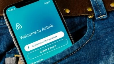 Airbnb cleaning fee, airbnb app on cellphone