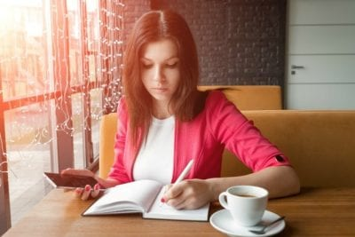 Challenges of Hiring Staff, Woman at Lunch Writing Notes