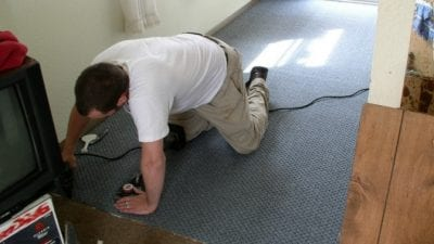 Clean or Paint First handyman tacking down carpet