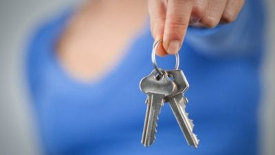 Fire My Cleaning Lady woman holding house keys