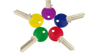 House Keys color coded keys on white background