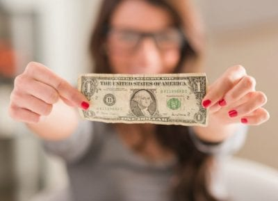 How Long Does it Take, Woman Holding One Dollar