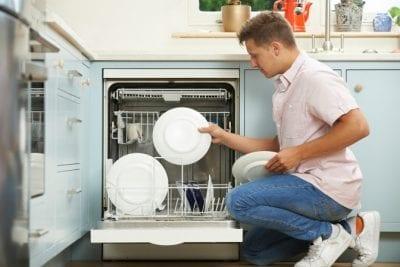Over-Delivering, Man Loading Dishwasher