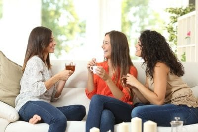 Over-Delivering, Three Women on Couch Chatting