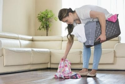 Over-Delivering, Woman Picking Up Clothes