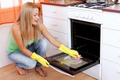 Questions to Ask on a Walkthrough, Woman Cleaning Oven