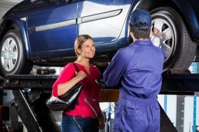 Savvy Perks, Woman Talking to Mechanic