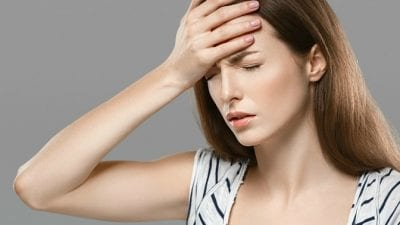 Suspend House Cleaning Service exhausted woman with hand on her head