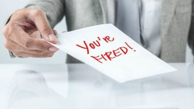 Suspend House Cleaning Service man holding you're fired card